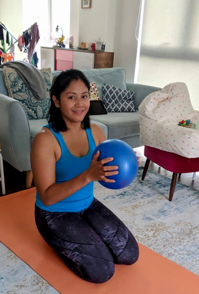 Melanie with exercise ball on mat.